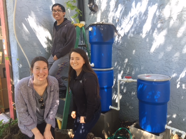 Natalia, Michael and Amy after completion of their storm water capture and cleaning system for helping CNGF students understand how to reuse storm water. This was an EPICS PROJECT